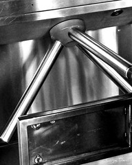 Turnstile Close-up, Harrison PATH (Tony Fischer Photography) Tags: blackandwhite bw reflection silver subway blackwhite newjersey industrial harrison mechanical path metallic nj machine turnstile