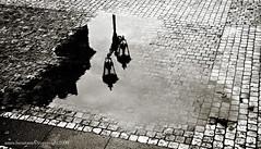 Prague 25 (farnitano.amos) Tags: street city blackandwhite bw water reflex europe prague praha praga bn acqua biancoenero lampione citt riflesso