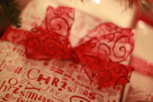Photo of a gift wrapped in Christmas paper.