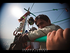 shooting with one hand (Shabbir Ferdous) Tags: blue sea color colour water boat fishing photographer shot natural song bangladesh bangladeshi travelpicture sigma1020mmf456exdchsm thebayofbengal canoneos5dmarkii shabbirferdous swatchofnoground wwwshabbirferdouscom shabbirferdouscom
