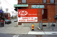 Annette St - April 4, 1999 (collations) Tags: signs toronto ontario architecture documentary signage vernacular kitkat streetscapes builtenvironment cornerstores conveniencestores urbanfabric varietystores