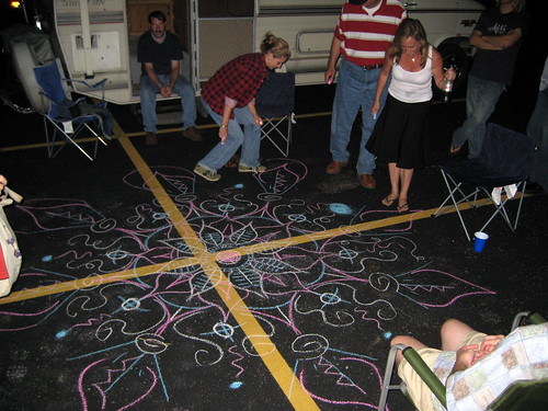 Everyone helping draw a huge mandala at Paul's