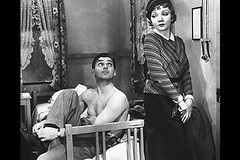 Ellen (Colbert) eyes a shirtless Clark Gable