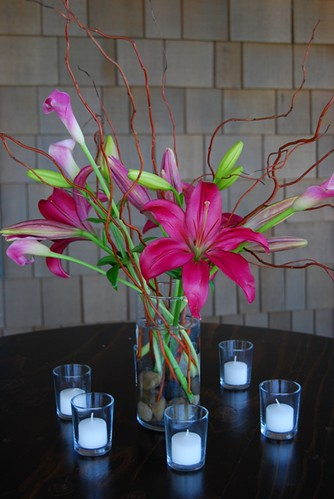 Table centerpiece with lilies and curly willow