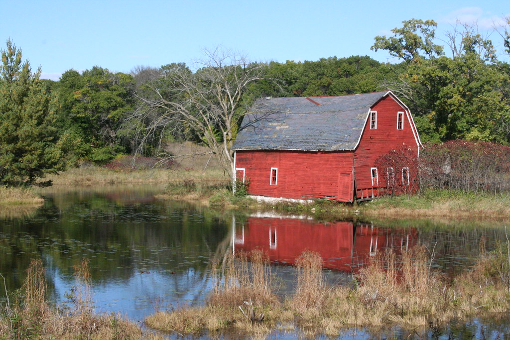 Barn reflected in pond