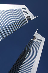 Emirates Towers, Dubai (sminky_pinky100 (In and Out)) Tags: city travel blue tourism architecture buildings shopping hotel dubai skyscrapers artistic uae tall emiratestowers stylish kartpostal omot clanflickr