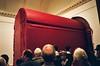 Svayambh - Amazing Anish Kapoor wax sculpture moving through the Royal Academy (deepstoat) Tags: red london film 35mm yashicat5 wax busted anishkapoor royalacademy autaut svayambh deepstoat likeahugeredbusmovingthroughthegallery