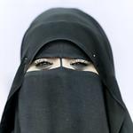 Miss Mouna smiling under her veil, Salalah, Oman