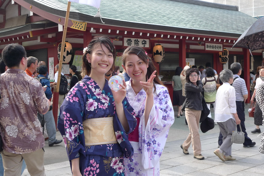 Two girls in Yukata at senso-ji temple during hozuki ichii