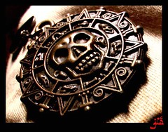 """This is Aztec gold... (*Jia { ing lyf }) Tags: randomness pirate medallion jia piratesofthecaribbean aztecgold hexatanimportantmeetinsoikilledtymtakinrandompixp captainjacksparrowd monstaaamonstaaamonsttaaaaa okkkkithnkihadtoomuchcoke waitinfohistext"