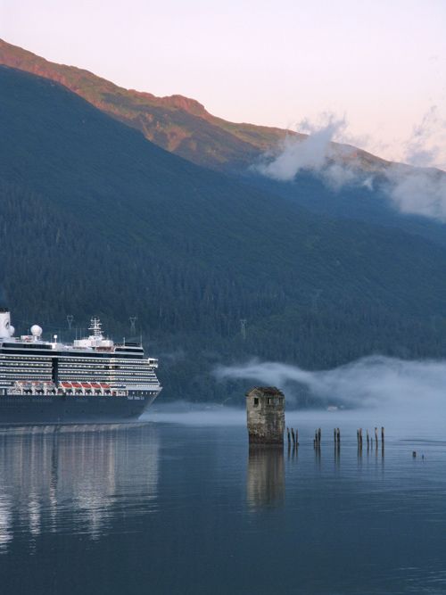 a cruise ship passes Sandy Beach in Douglas, as it heads down Gastineau Channel leaving Juneau, Alaska