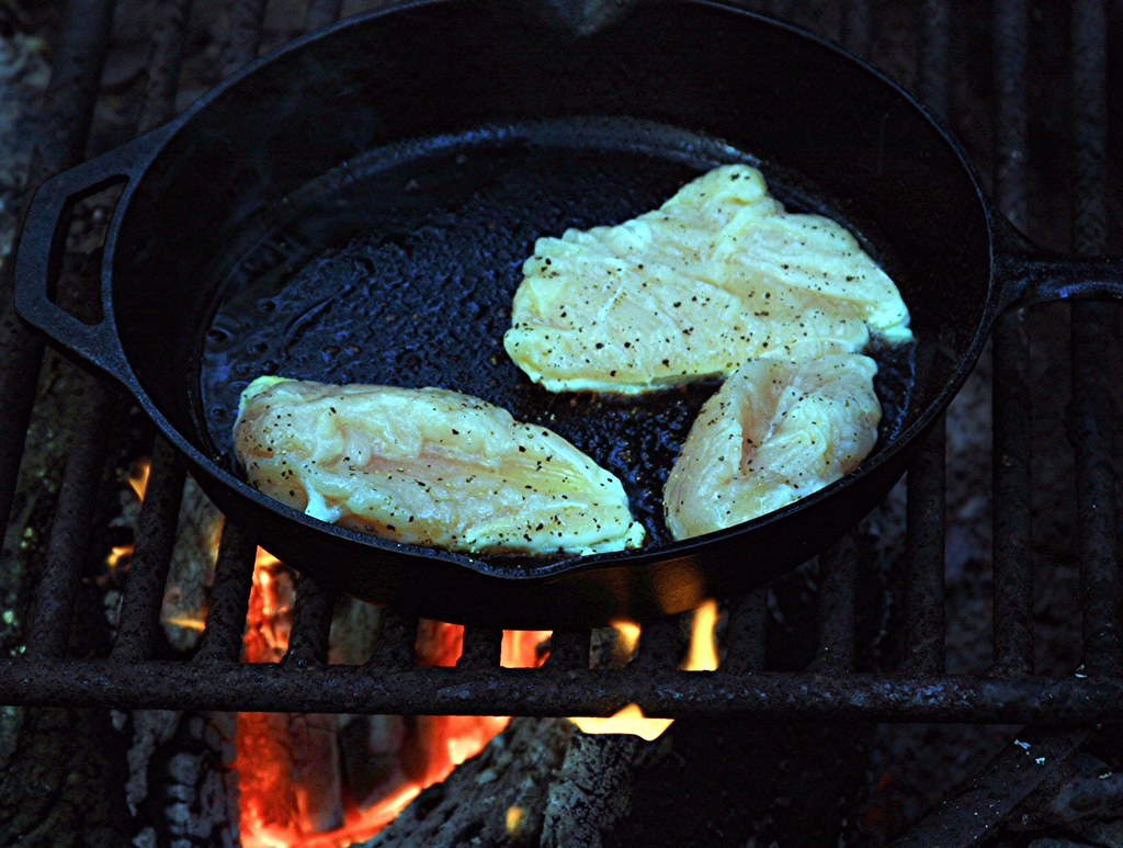 Cooking Seasoned Chicken Breasts Over The Campfire