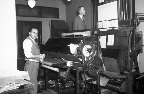 Men with printing press, circa 1930s by Seattle Municipal Archives, on Flickr