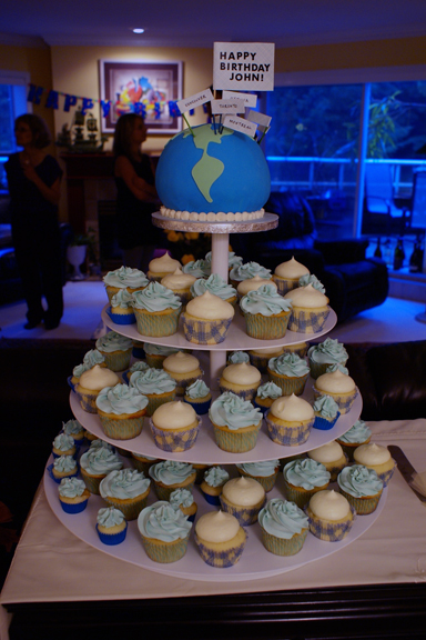 70th birthday celebration! world cake and cupcakes