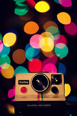 Have a Very Bokeh Christmas (Brandon Christopher Warren) Tags: christmas camera eve pink blue red orange green film yellow polaroid lights rainbow colorful bokeh land christmaseve polaroidsx70 bokehlicious eos5dmarkii instantback amazinggift