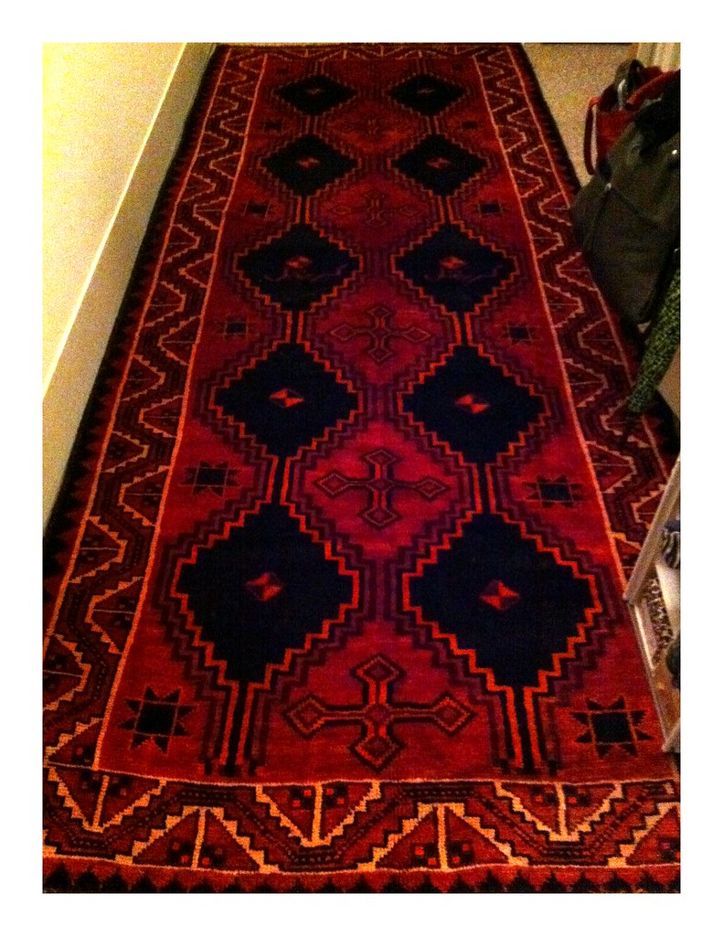 Score: red wool Persian rug!