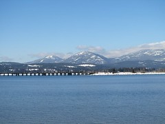 Sandpoint, Idaho: The City on the Lake (Designer Michael) Tags: bridge winter sunlight lake mountains water lakependoreille mountainrange funinthesun sandpointidaho
