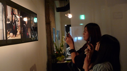 Photo of Kaori and Mayuri taking photos of the photos they modelled for
