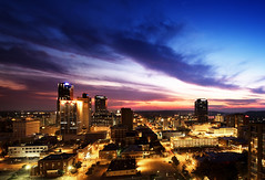 Million dollar view. (clay.wells) Tags: county plaza city pink blue light sunset summer moon tower rock skyline clouds america canon buildings river lens eos hotel evening michael interesting cityscape skyscrapers stitch natural little metro market dusk clayton bruce union towers bank august wells crescent explore capitol national hour motor arkansas usm dowtown stephens 2009 metropolitan ef peabody 1740 doubletree pulaski regions ultrasonic arq bordelon bigmomma f4l 40d thechallengefactory pushaldermanofftheroof lit1stitchv2 claytonwells