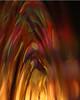 Solar flare (Mukumbura) Tags: red abstract macro green reflections gold waves ripples solarflare birthdayballoon waterdropmacro