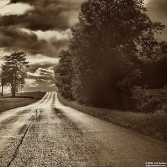 Down The Road a Bit (jeff_golden) Tags: road trees sepia clouds geotagged 1755f28is photoaday2009