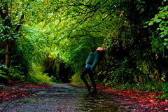 (look left and look right) Tags: summer greenleaves girl leaves pose path tunnel raining soaking blackness headback