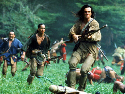 The Last of the Mohicans holding a gun in battle