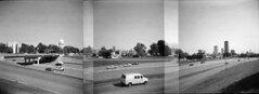highways and byways (windybug) Tags: blackandwhite bw panorama film skyline buildings mediumformat holga lomography cityscape skyscrapers stitch state littlerock pano capital toycamera capitol transportation hp5 arkansas interstate vignetting ilford statecapitol 120n statecapital blackandwhitefilm pulaskicounty ilfordhp5400 incamerastitch i630 filmstitch littlerockset