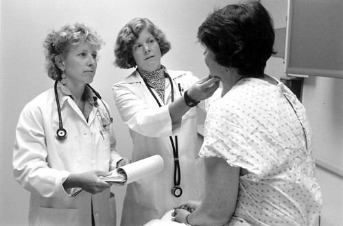 Doctors with patient, 1999 by Seattle Municipal Archives, on Flickr