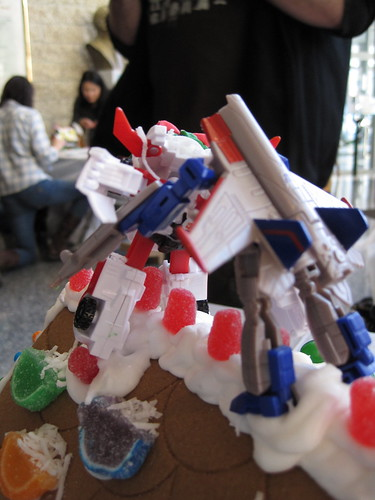Transformers fight an epic battle atop the Unknown Studios gingerbread house