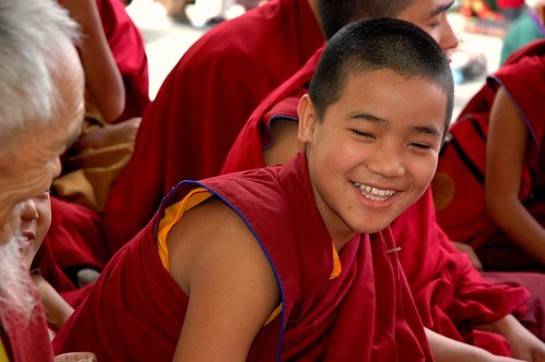 Laughing! A young monk with an elder monk, Tharlam Monastery Courtyard, Boudha, Kathmandu, Nepal by Wonderlane