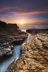 In The Groove - Davenport, California (Jim Patterson Photography) Tags: ocean california longexposure blue light sunset sea sky usa santacruz sun seascape reflection water vertical clouds landscape gold coast marine rocks waves pacific cove tripod shoreline scenic rocky wideangle erosion coastal shore lee coastline intertidal davenport cracked reallyrightstuff remoterelease nikkor1224mm graduatedneutraldensityfilter singhray nikond300 markinsm20ballhead jimpattersonphotography jimpattersonphotographycom seatosummitworkshops seatosummitworkshopscom