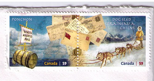 Canadian dog sled and barrel mail stamps