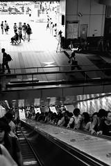 Journey from the centre of the Earth (Redt16s) Tags: blackandwhite monochrome nikon escalator taiwan streetphotography taipei mrt emerging zhongxiaofuxing nikkor50f18d