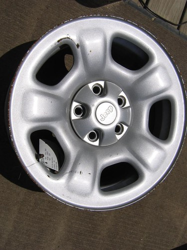 This is a photo of a styled steel wheel. The wheel is made from steel but formed into a design and painted. You will find this type of wheel most commonly on trucks and some Jeeps and SUVs.