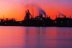 Industrial Sunset (Billy Wilson Photography) Tags: longexposure sunset ontario canada reflection industry water digital canon reflections river dark landscape eos rebel lowlight smoke sunsets pollution xs soo northern current saultstemarie northernontario algoma steelmill billywilson industrialsunset platinumheartaward essarsteel