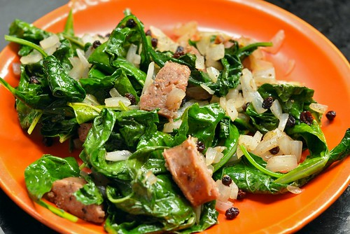Sauteed kale with spiced Niman Ranch sausage, sweet onions, and currants