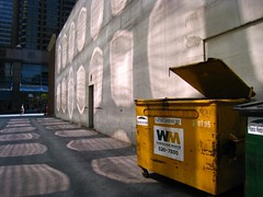 by the light (SqueakyMarmot) Tags: urban reflection vancouver dumpster alley downtown pattern caustics neighbourhood garbagebin parkplace hornbystreet
