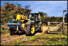 The Yellow Forklift. (Pat Dalton...) Tags: blue sky tractor field grass sign canon raw leicestershire gates country sigma lane driver bushes forklift bridleway 1770mm 450d hedg peatlingmagna contrastmaster pdeee454