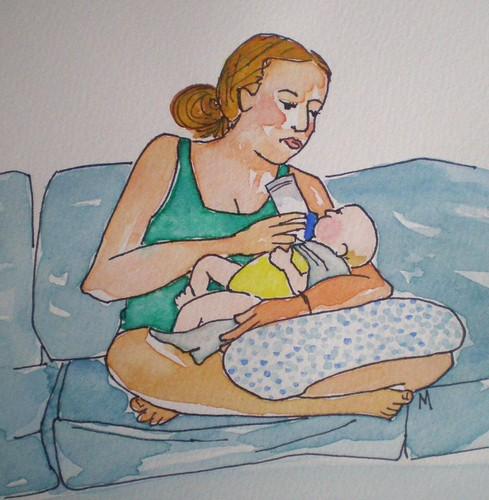 Brianna feeding baby Mila