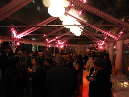 The reception was held on the roof, but incliment weather brought out the tent.