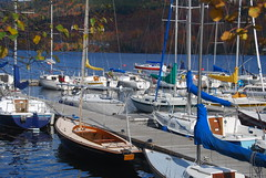 Toys for the boys (Let Ideas Compete) Tags: park travel autumn lake canada fall water rock marina pier dock colorful quebec montreal sails lac canadian resort adventure sail mast colourful sailboats tremblant foilage masts affluence rigging toysforthewealthy richpeoplestoys