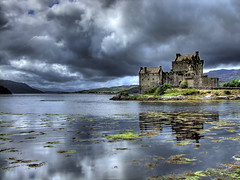 Eilean Donan Castle....where the Lords of the Isles lived (Lumatic) Tags: travel sky lake storm reflection building castle history nature topf25 rain weather horizontal architecture clouds digital landscape outdoors island shower photography mirror scotland photo highlands topf50 topf75 flickr exterior wind photos ominous topv1111 picture tranquility nopeople scene medieval online fjord loch clan topf100 stronghold fortress idyllic eilean donan digitalphoto tranquil scenics digitalphotos dornie clans refelections lotse lochduich eileandonancastle traveldestinations beautyinnature nationallandmark photosonline photoonline lumatic