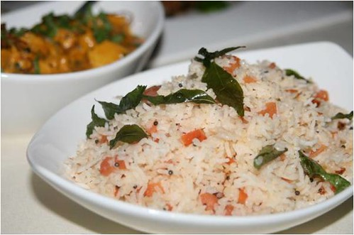Tomato  flavored Indian basmati rice was fluffy and infused with curry leaves,  saffron, and mustard seed.