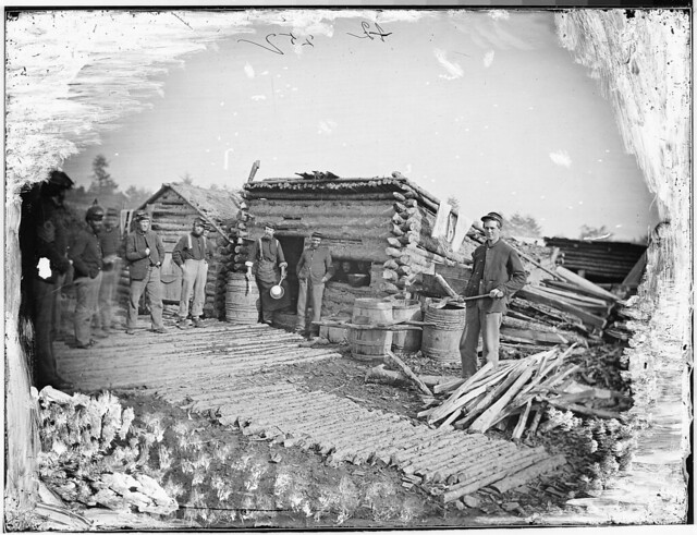 Camp scene showing Company kitchen by The US National Archives