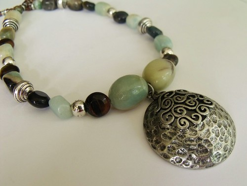 http://www.etsy.com/listing/73943247/earth-and-water-natural-gemstone-bead by mSs Distinctive Designs Studio