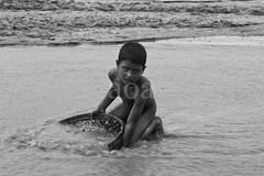 E3-1_1388 Gloss (bandashing) Tags: poverty boy england bw water monochrome rock dark naked manchester stream child poor pebbles labour sylhet bangladesh bandashing