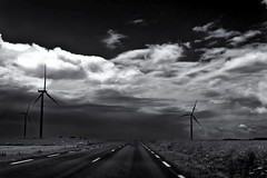 Driving in France (Guido Musch) Tags: trees blackandwhite france clouds one nikon windmills frankrijk windturbine petit d40 guidomusch vivitar28mm25 drivography idontknowwhereisomewherebetweenluxembourgandreimsbutthatcanbealot silhouetteroadonly carsome maybeabittodarktoomuchcontrast