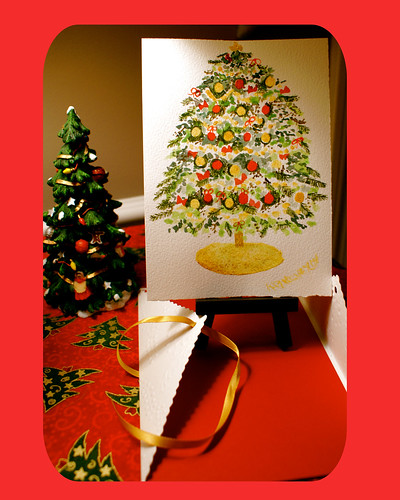 Christmas Tree Watercolor painting ready to display on an easel