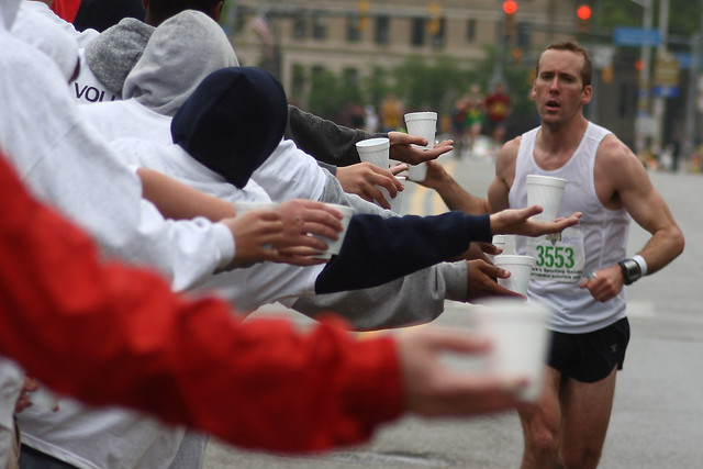 Marathon runner gets refreshment